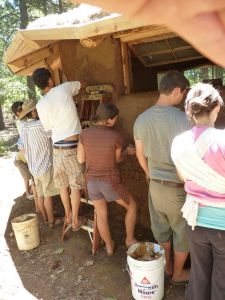 2012 Living With Spirit Plastering the Bale Cob Classroom