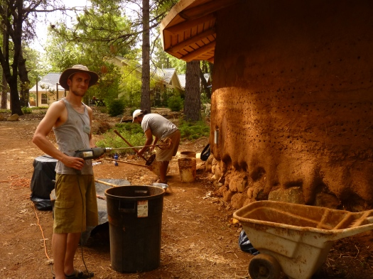 Wesley mixing some plaster for the cob classroom