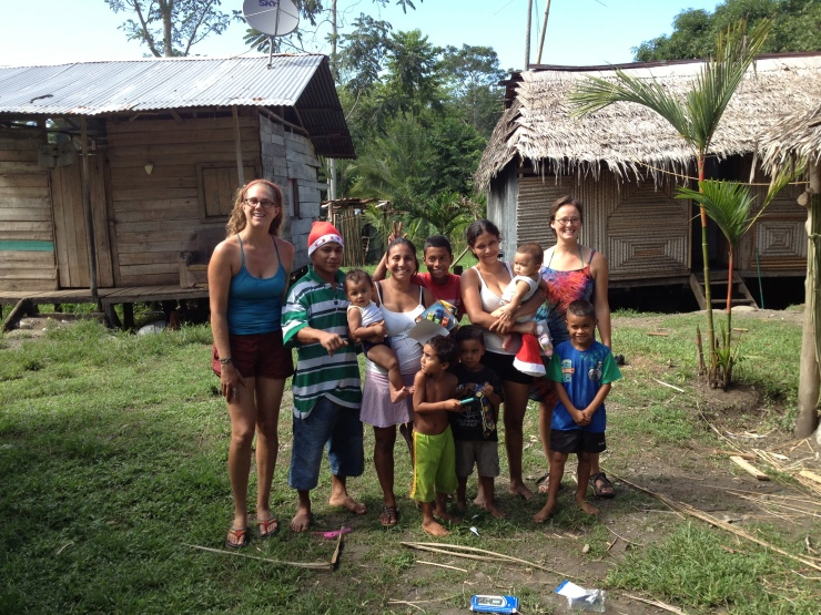 Christmas in the Caribbean was well spent handing out gifts to the local children and sharing  a meal with our host family. Here are apprentices Melissa and Alyssa with the family.