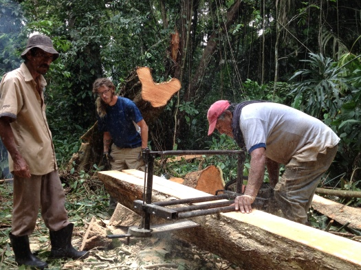 Don Jacinto and Billete showing us how to use the Alaskan Mill to cut lumber for traditional Costa Rican Homes.