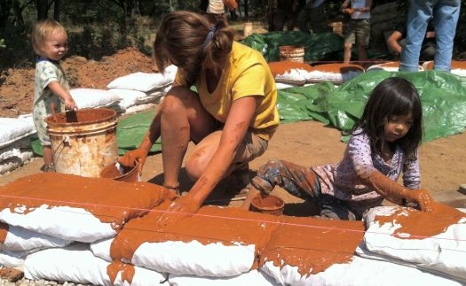 Ninette, Esme and Solis getting slip on the earth bag foundation