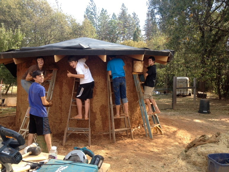 High School Boys Building a cob pump house